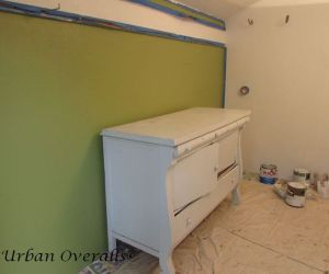 Green wall with buffet turned potting bench