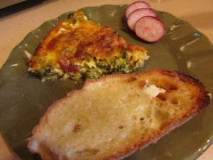 breakfast of quiche, toast and radish