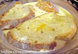 bread soaking in custard mixture