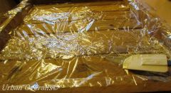 wooden mold lined with plastic wrap